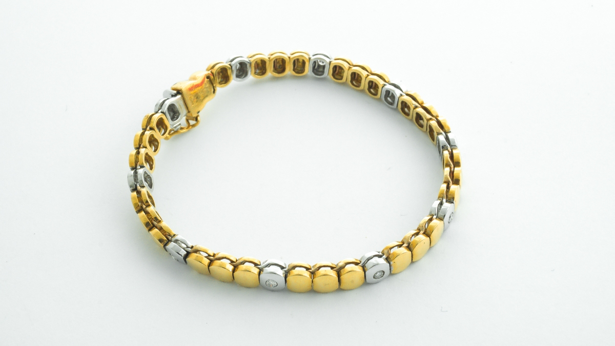 18ct yellow and white gold diamond bracelet in Ipswich, Suffolk