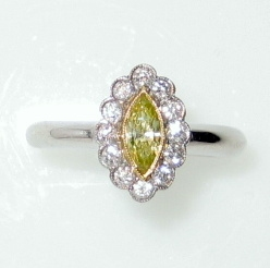 Platinum marquise yellow diamond cluster ring