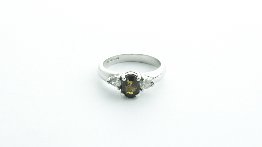 alexandrite and diamond 18ct ring with one pear shaped diamond either side