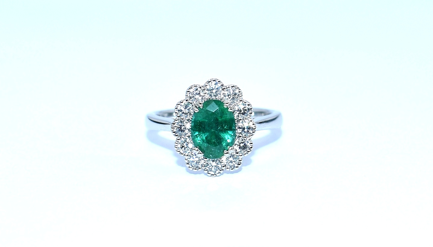 White gold emerald and diamond cluster engagement ring in Ipswich, Suffolk