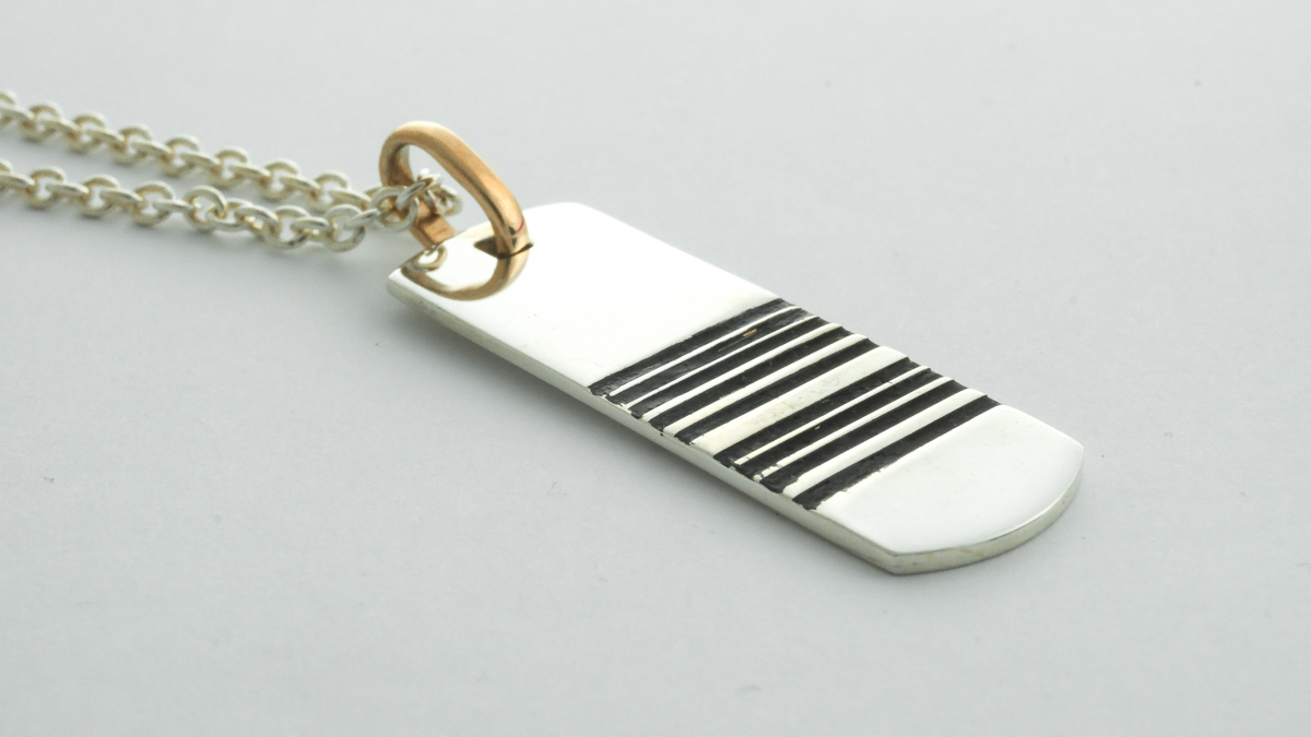 Silver men's dog tag style barcode pendant in Ipswich, Suffolk