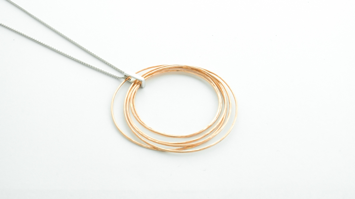 9ct rose gold circles pendant with diamond bail in Ipswich, Suffolk