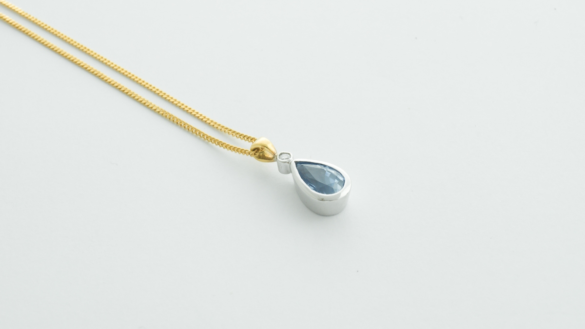 18ct white and yellow gold pear shaped 1.55ct blue sapphire and diamond pendant in Ipswich, Suffolk