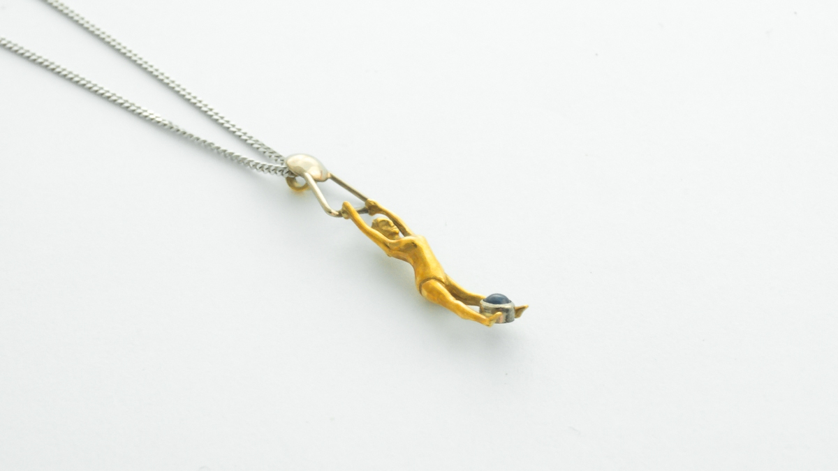 18ct yellow and white gold acrobat pendant in Ipswich, Suffolk