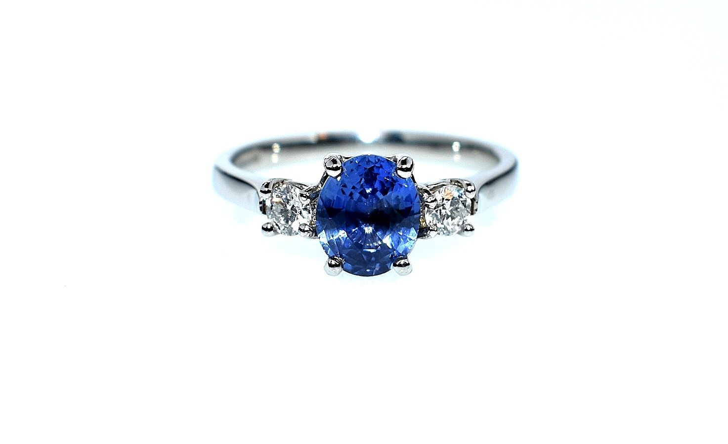 18ct white gold colour changing sapphire and diamond ring
