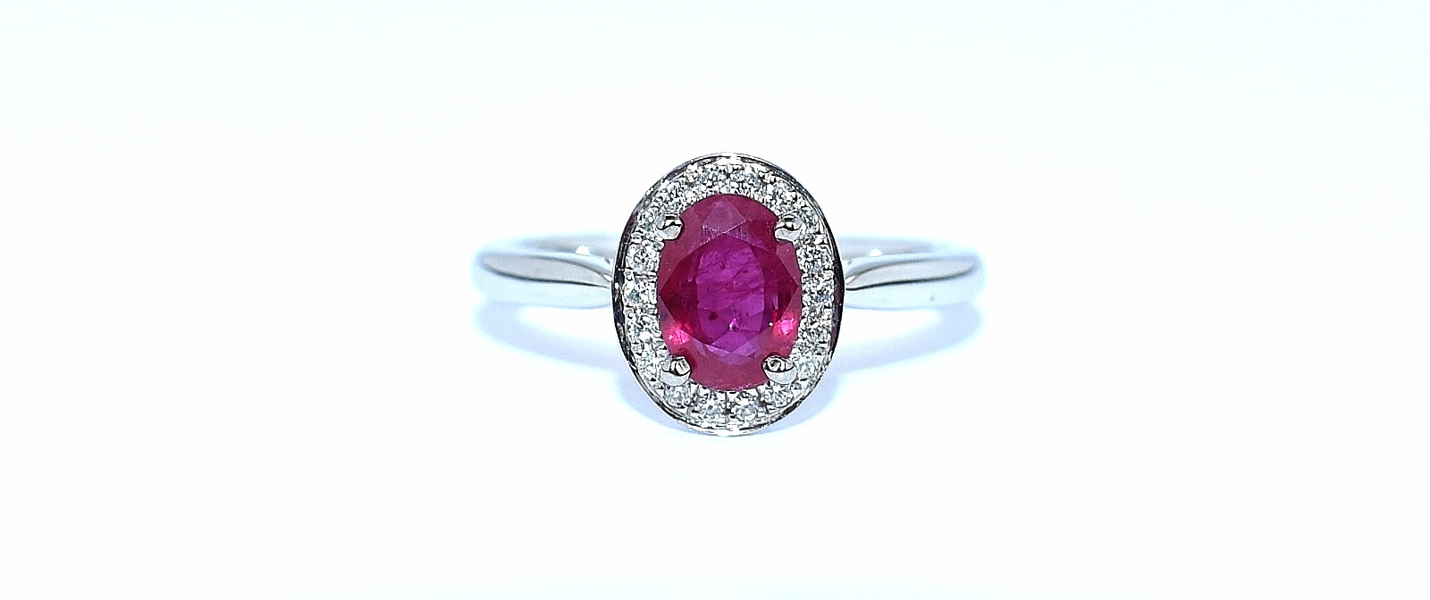18ct white gold oval ruby and diamond cluster ring