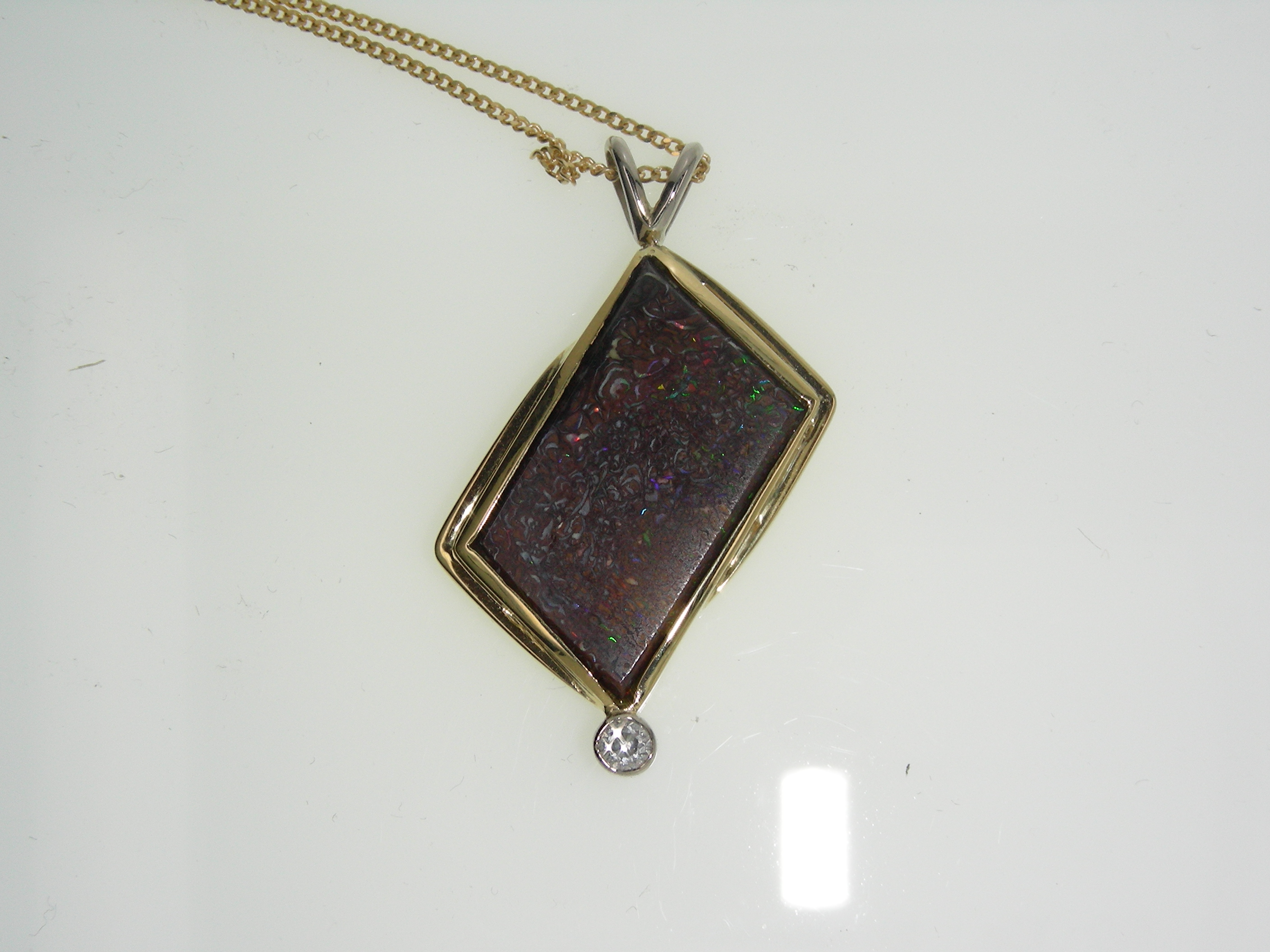 gold and boulder opal pendant