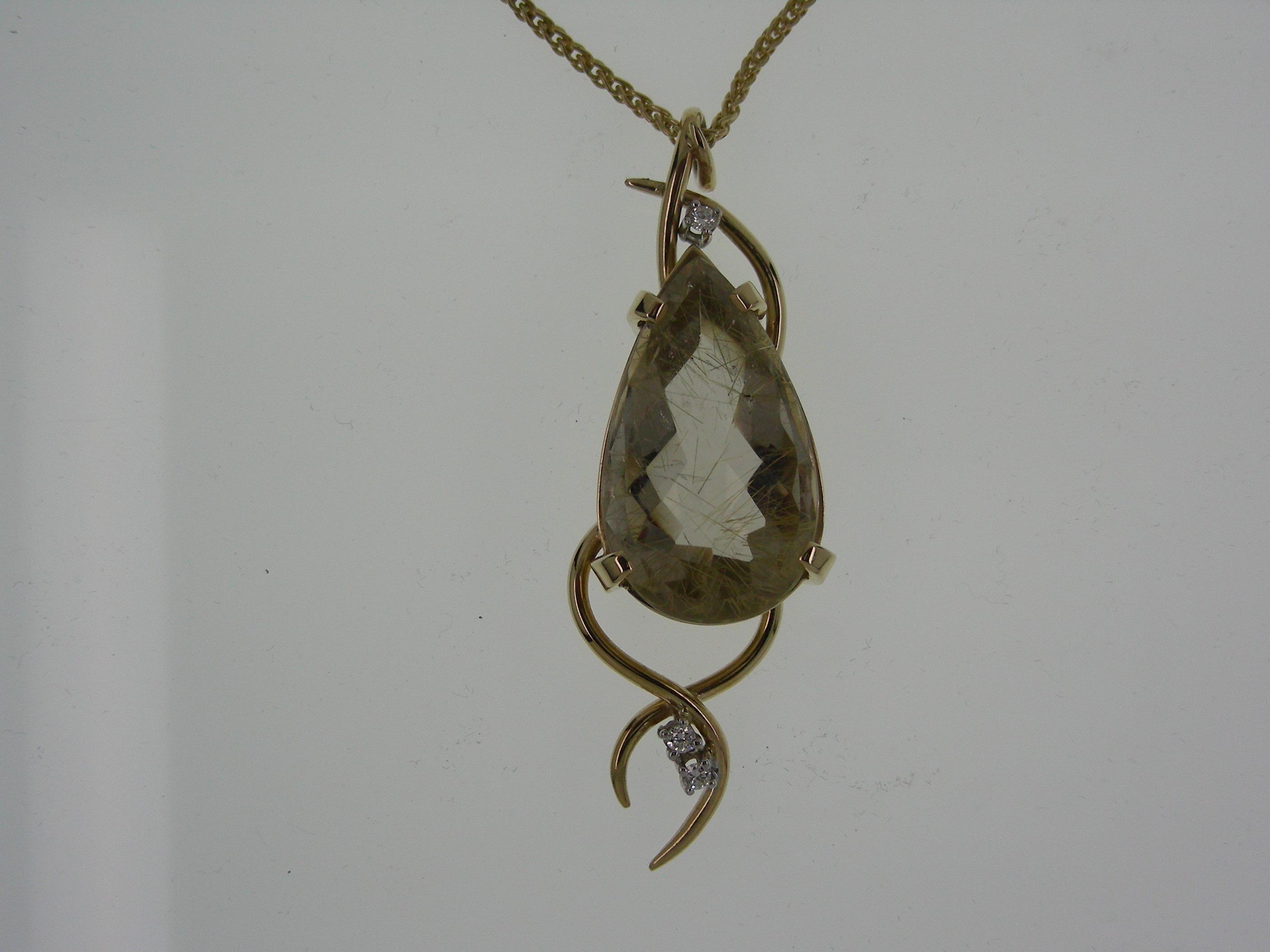 gold and rutilated quartz pendant